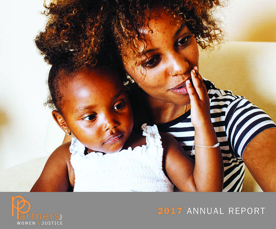 """woman holding toddler labeled """"2017 annual report"""""""