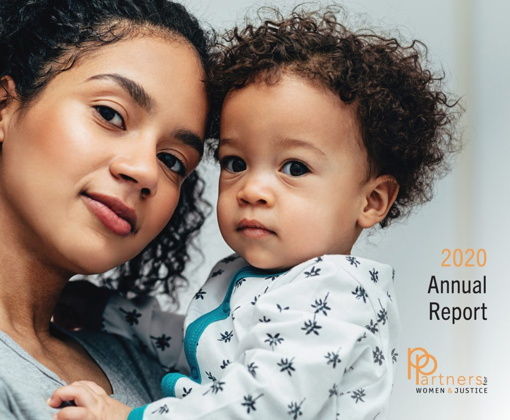 """woman holding toddler labeled """"2020 annual report"""""""
